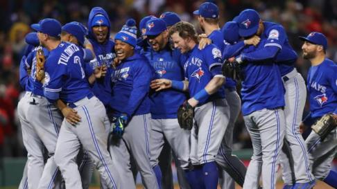 BOSTON, MA - OCTOBER 02: The Toronto Blue Jays celebrate clinching a Wildcard spot in the playoffs after their 2-1 win over the Boston Red Sox at Fenway Park on October 2, 2016 in Boston, Massachusetts. (Photo by Maddie Meyer/Getty Images)